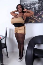 Free porn pics of Can anyone name this huge black tits slut? 1 of 1 pics