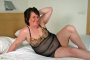 Free porn pics of Mature BBW works a glass dildo. 1 of 66 pics