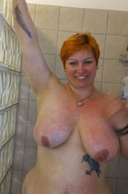 Free porn pics of Cute redhead with smooth pussy 1 of 25 pics